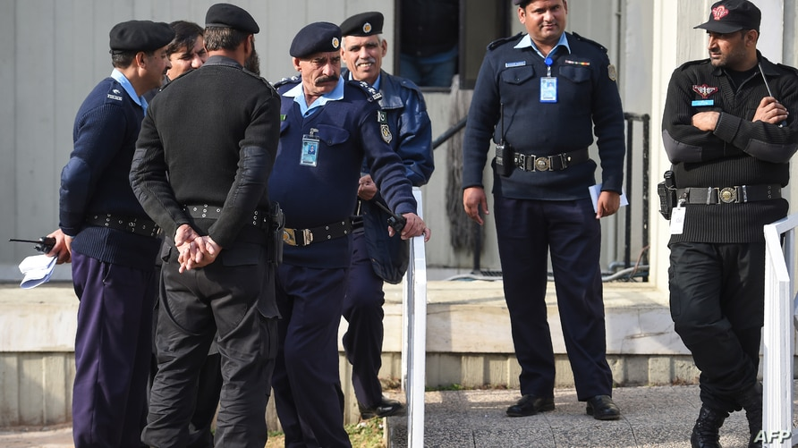 Pakistani policemen stand guard in front of the Supreme Court building