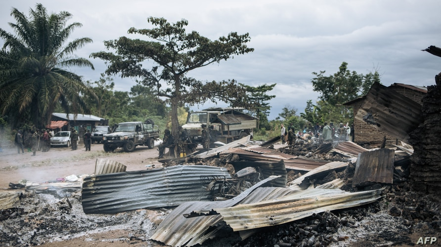 Burnt down houses are seen  in the village of Manzalaho near Beni on February 18, 2020, following an attack  allegedly…