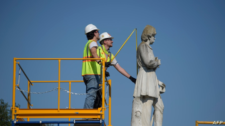 Houston city workers remove a statue of confederate soldier Dick Dowling from Hermann Park on June 17, 2020 in Houston, Texas. …