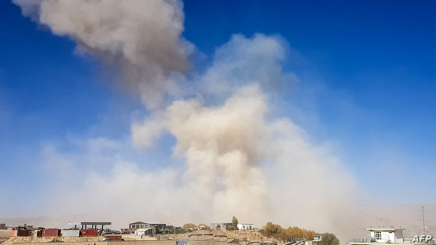 Smoke rises from the site of a car bomb attack that targeted an Afghan police headquarters in Feroz Koh, the capital of Ghor…