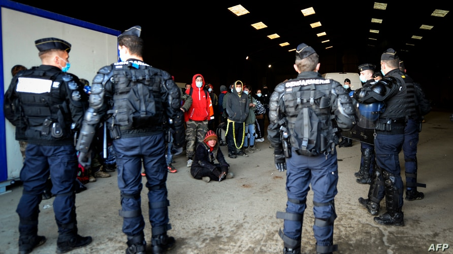 French Gendarmes break up a rave near a disused hangar in Lieuron about 40km (around 24 miles) south of Rennes, on January 2,…
