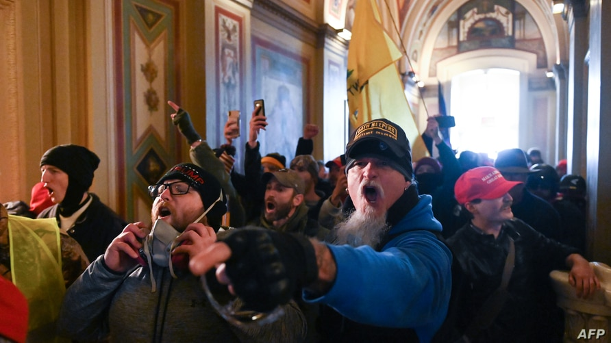 Supporters of US President Donald Trump protest inside the US Capitol on January 6, 2021, in Washington, DC. - Demonstrators…