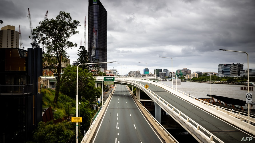 A deserted Riverside Expressway is seen on the first day of a snap lockdown in Brisbane on January 9, 2021, with officials…