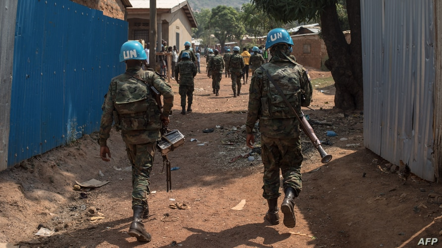 United Nations Multidimensional Integrated Stabilization Mission in the Central African Republic (MINUSCA) soldiers patrol in…