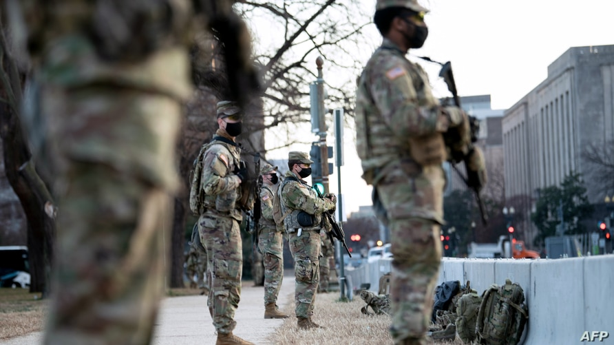 Members of the National Guard are seen guarding Capitol Hill in preparation for the US Presidential Inauguration a week after a…