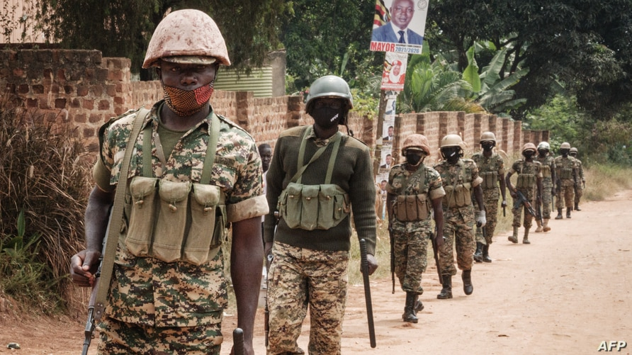 Ugandan soldiers patrol near the street leading to the house of Robert Kyagulanyi, also known as Bobi Wine, in Magere, Uganda,…