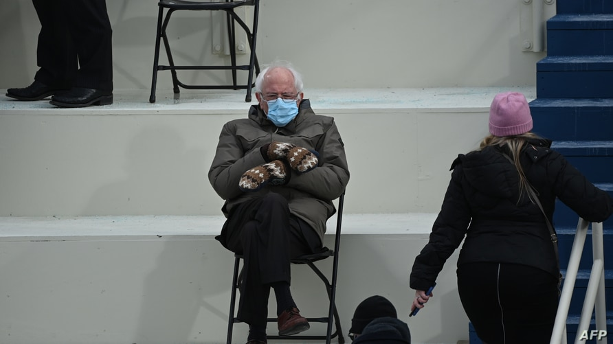 (FILES) In this file photo taken on January 20, 2021 Former presidential candidate, Senator Bernie Sanders (D-Vermont) sits in…