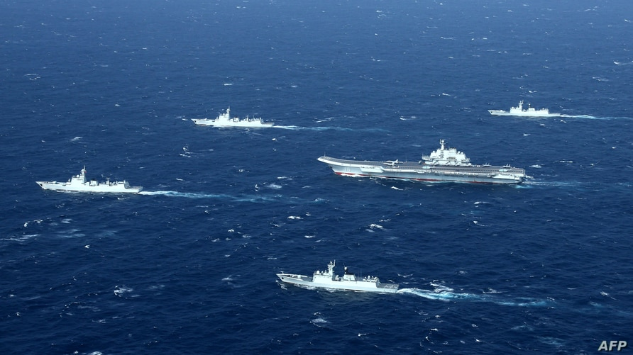 This photo taken on January 2, 2017 shows a Chinese navy formation, including the aircraft carrier Liaoning (C) during military…