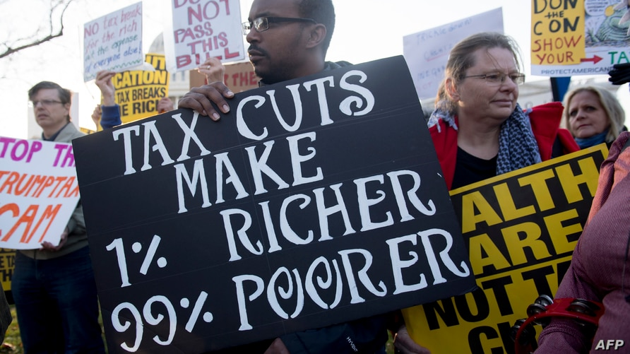 "Demonstrators against the Republican tax reform bill hold a ""People's Filibuster to Stop Tax Cuts for Billionaires,"" protest…"
