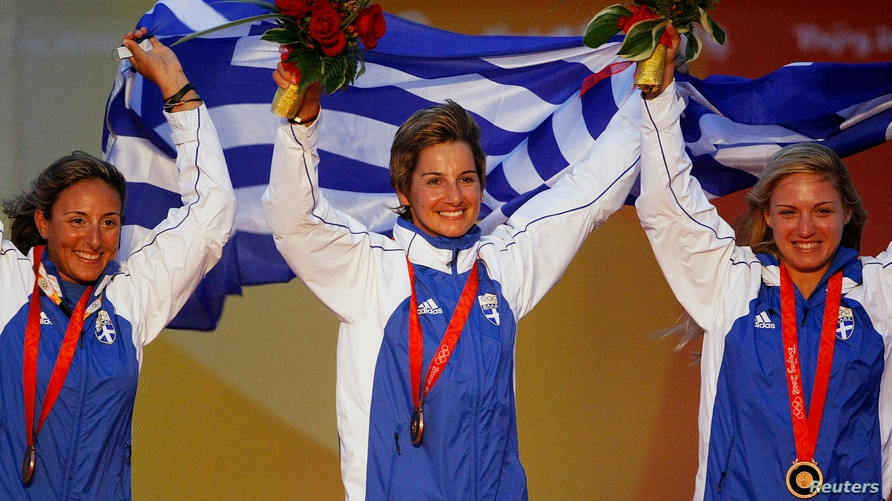 From L to R: Sofia Bekatorou, Sofia Papadopoulou and Virginia Kravarioti of Greece celebrate with their bronze medals after the…