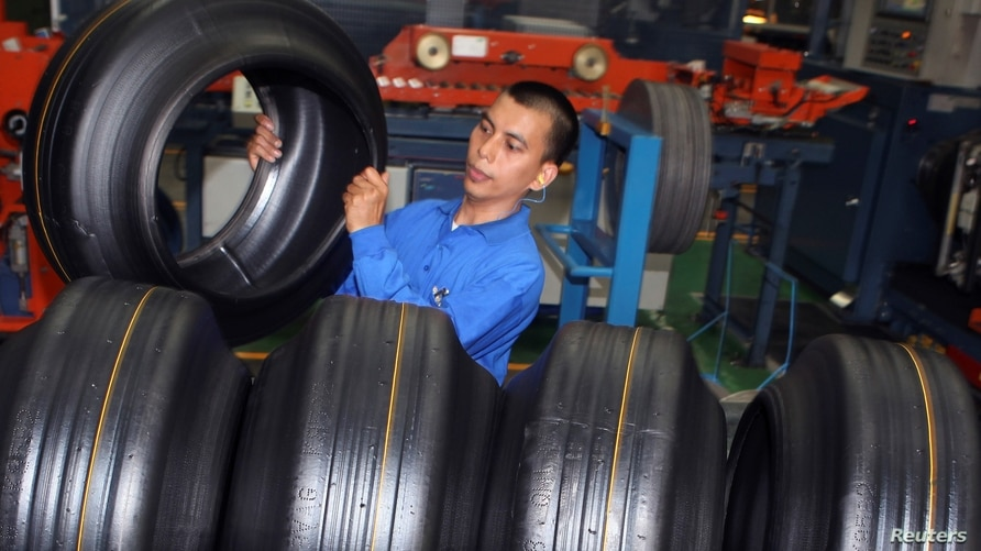 A worker removes a tire during a production in a Goodyear factory in Bogor of the Indonesia's West Java Province April 29, 2010…
