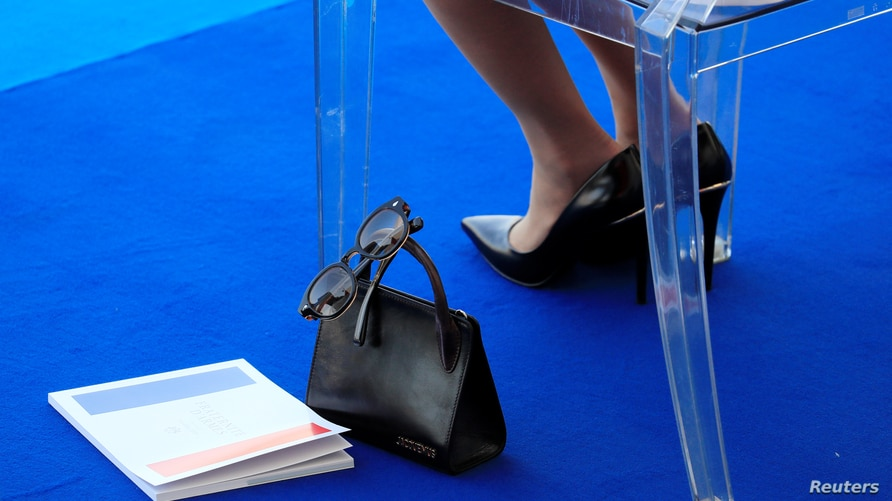 The handbag of Brigitte Macron, wife of French President Emmanuel Macron, are seen as she attends the…