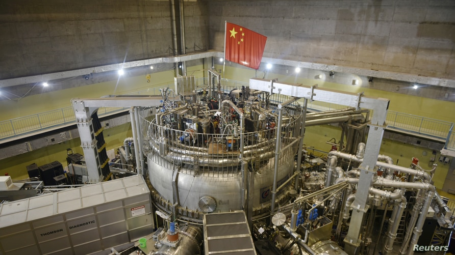A Chinese flag is seen atop the Experimental Advanced Superconducting Tokamak (EAST), a nuclear fusion reactor dubbed as …