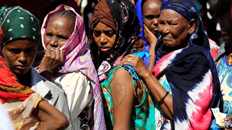 Ethiopian refugees who fled Tigray region, queue to receives treatment within the Fashaga camp on the Sudan-Ethiopia border, in Kassala state, Sudan, Dec. 14, 2020.