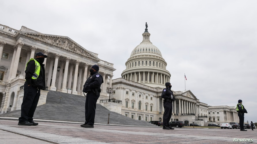 U.S. Capitol Police stand guard on a plaza surrounding the Capitol before Congress meets to certify the electoral college vote.
