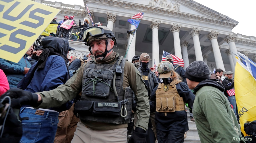 FILE PHOTO: Members of the Oath Keepers are seen among supporters of U.S. President Donald Trump at the U.S. Capitol during a…