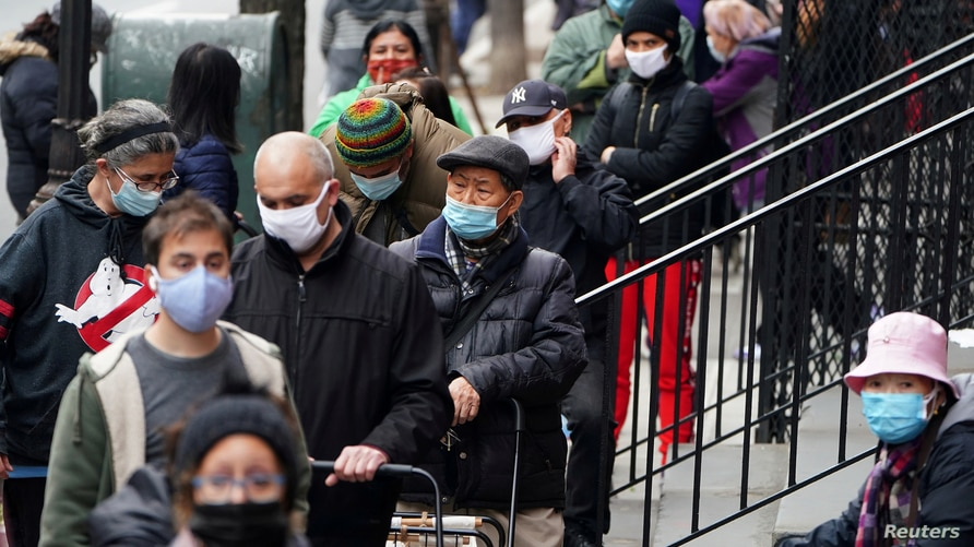 FILE PHOTO: People wait in line at the St. Clements Food Pantry for food during the coronavirus disease (COVID-19) pandemic in…