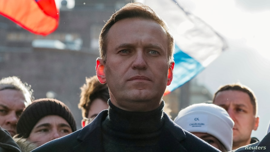 FILE - Russian opposition politician Alexei Navalny takes part in a rally in Moscow, Russia, Feb. 29, 2020.