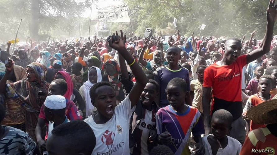 Sudanese civilians protest against United Nations Hybrid Operation in Darfur (UNAMID) exit in Zalenjei, West Darfur, Sudan…