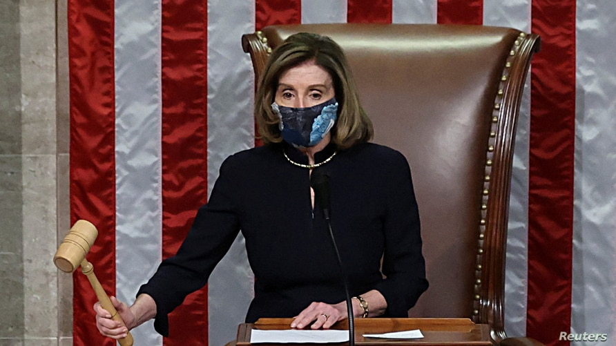 U.S. House Speaker Nancy Pelosi (D-CA) presides over the vote to impeach President Donald Trump for a second time, a week after…