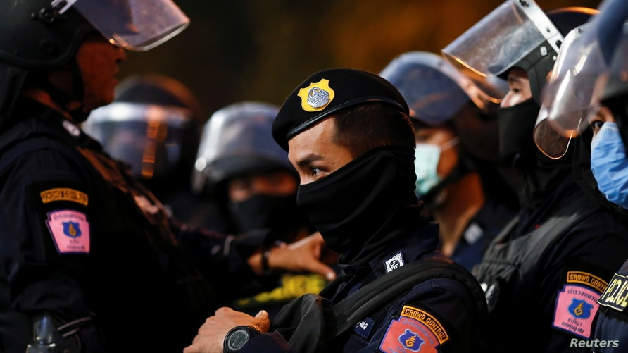 A police officer stands guard during a demonstration demanding to release the people arrested following the anti-government and reforming monarchy protests in Bangkok, Thailand, Jan. 16, 2021.