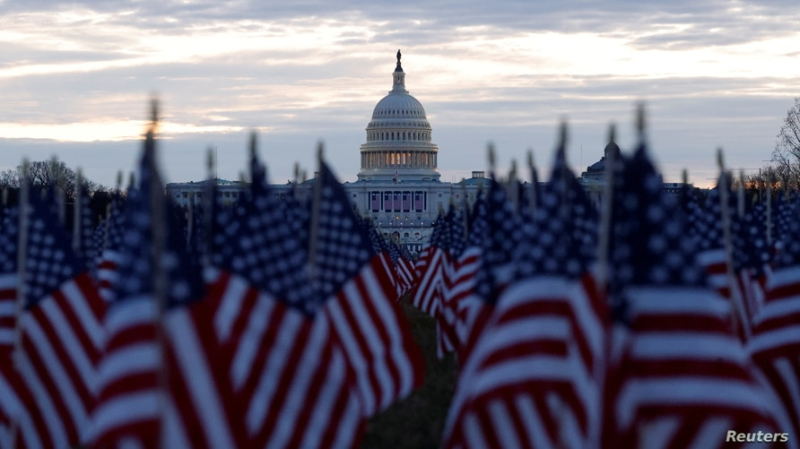 Thousands of U.S. flags are seen at the National Mall, to represent the people who are unable to travel to Washington for the…
