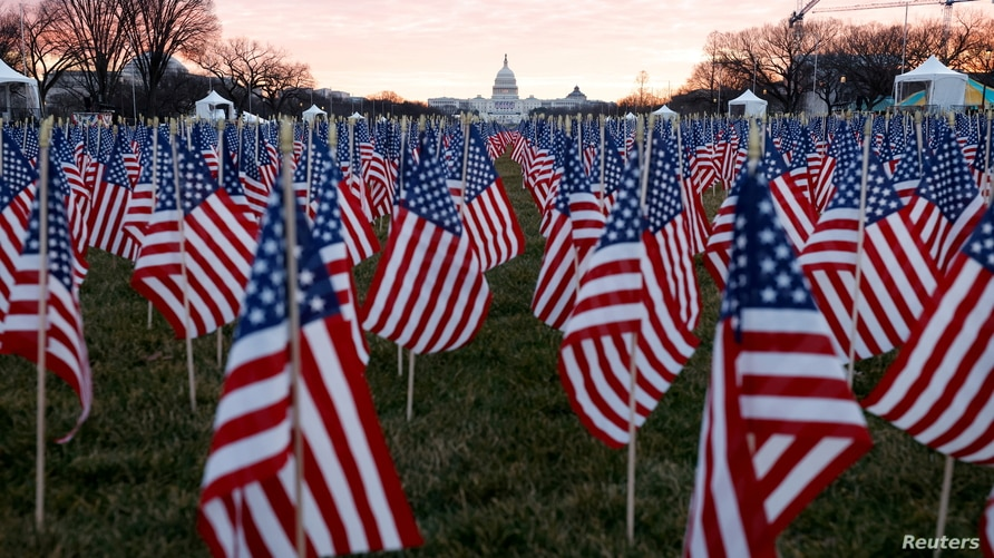 Thousands of U.S. flags are seen at the National Mall, to represent the people who are unable to travel to Washington.