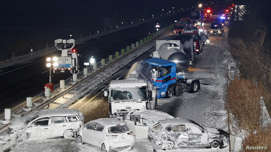 General view shows the site where cars were involved in a series of crashes when a snow storm struck a stretch of highway on…