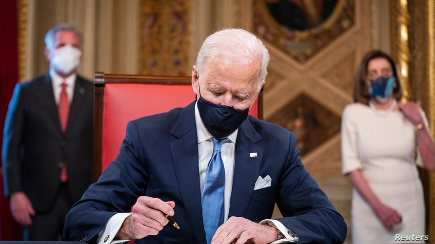 U.S. President Joe Biden signs three documents including an Inauguration declaration, cabinet nominations and sub-cabinet nominations in the Presidents Room at the U.S. Capitol after the 59th Presidential Inauguration in Washington, U.S., Jan. 20, 2021.