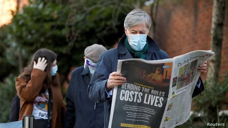 A man reads a newspaper as he waits to enter Lord's Cricket Ground to receive the coronavirus vaccine, amid the outbreak of the…