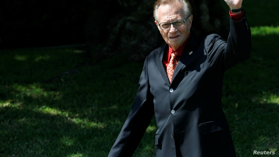 FILE - Larry King waves as he arrives at the funeral of entertainer and producer Merv Griffin at the Good Shepherd Catholic Church in Beverly Hills, California, U.S.,  August 17, 2007.