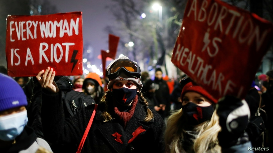 A demonstrator holds a placard during a protest against the verdict restricting abortion rights in Warsaw, Poland, January 28,…