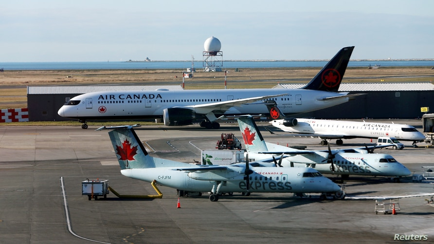 FILE PHOTO: Air Canada airplanes are pictured at Vancouver's international airport in Richmond, British Columbia, Canada,…