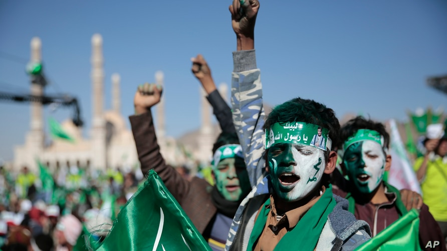 Supporters of Shiite rebels, known as Houthis, chant slogans as they attend a celebration of moulid al-nabi, the birth of Islam…