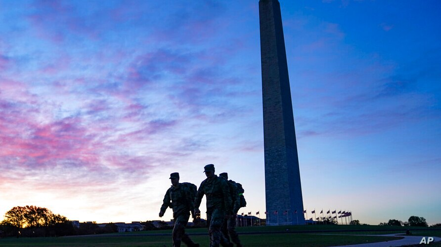 United States National Guard members walk towards the White House from the Washington Monument on Election Day, Tuesday, Nov. 3…