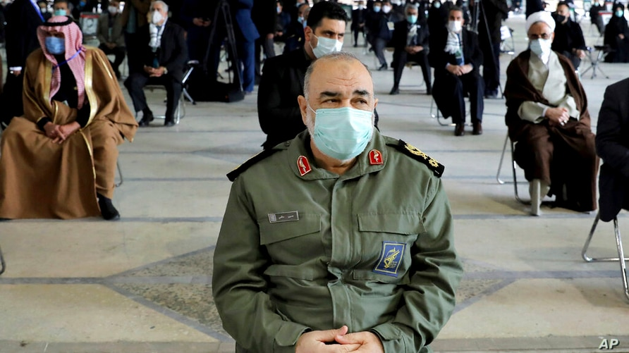 Chief of Iran's Revolutionary Guard Gen. Hossein Salami wearing a mask, attends a ceremony on the occasion of first anniversary…