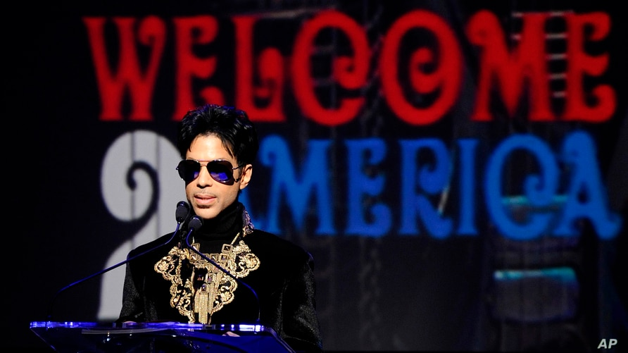 FILE - In this Oct. 14, 2010 photo, musician Prince holds a news conference at The Apollo Theater.