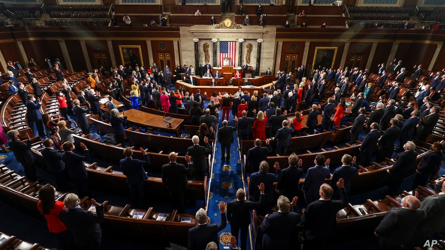 House Speaker Nancy Pelosi administers the oath of office to members of the 117th Congress at the U.S. Capitol in Washington,…