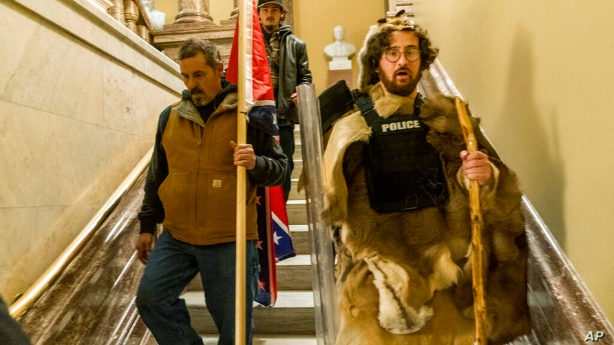 Supporters of President Donald Trump walk down the stairs outside the Senate Chamber as violence erupted at the Capitol after…