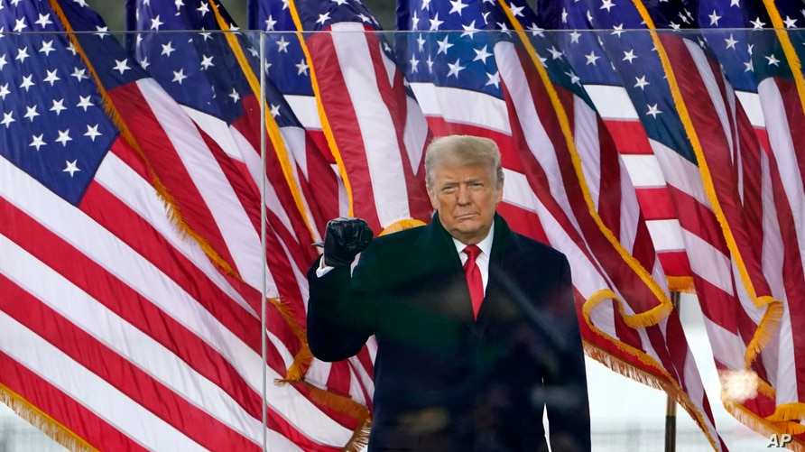 President Donald Trump arrives to speak at a rally, Jan. 6, 2021, in Washington.
