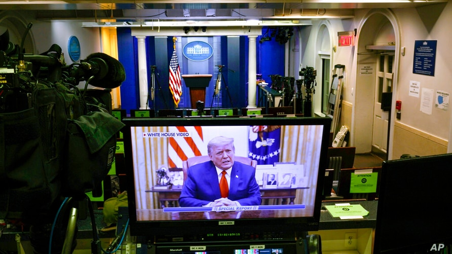 A video released by the White House, President Donald Trump shows a Twitter video on a television monitor in an empty press…