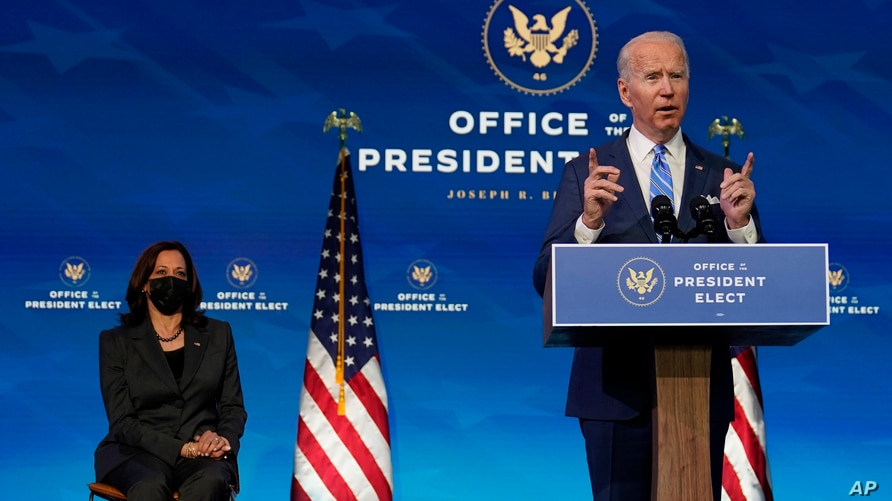 President-elect Joe Biden speaks about the COVID-19 pandemic during an event at The Queen theater, Thursday, Jan. 14, 2021, in…