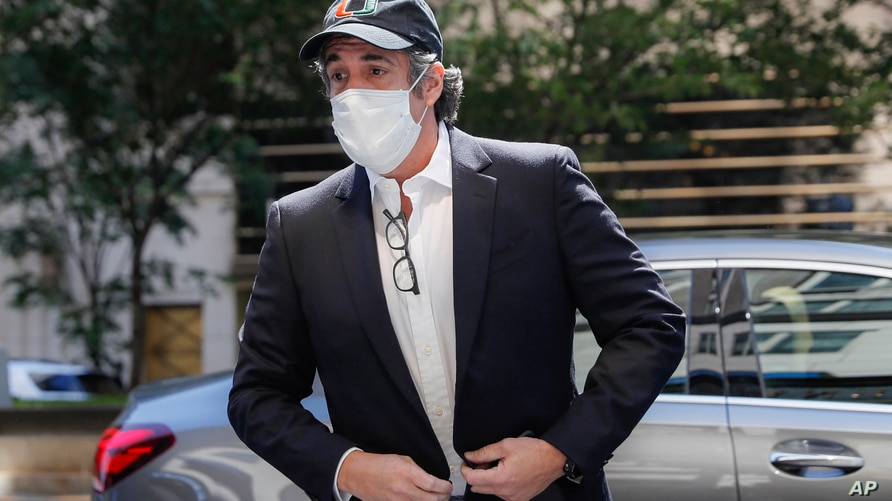 FILE- In this May 21, 2020 file photo, Michael Cohen arrives at his Manhattan apartment in New York after being furloughed from…