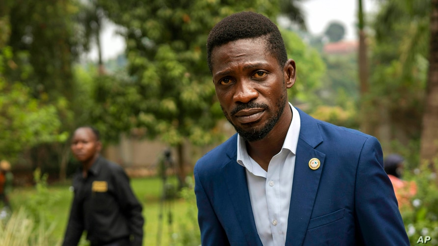 Uganda's leading opposition challenger Bobi Wine walks back to his residence after giving a press conference outside Kampala.