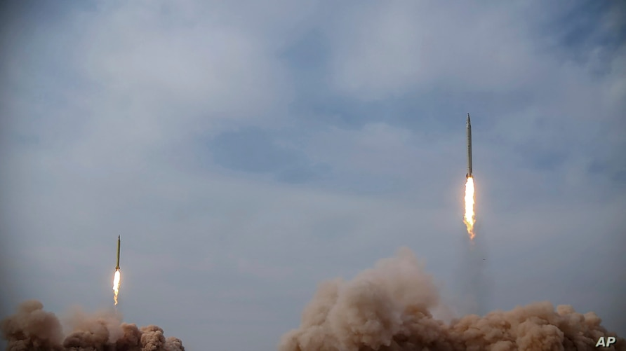 In this photo released on Saturday, Jan. 16, 2021, by the Iranian Revolutionary Guard, missiles are launched in a drill in Iran.