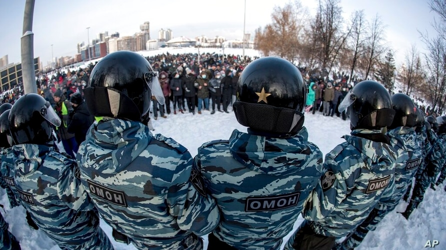 FILE - In this Jan. 23, 2021, file photo, police in Yekaterinburg, Russia, block a protest over the jailing of Alexei Navalny…