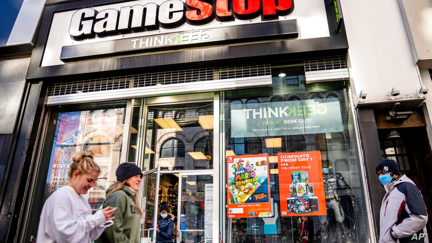 Pedestrians pass a GameStop store on 14th Street at Union Square, Thursday, Jan. 28, 2021, in the Manhattan borough of New York…