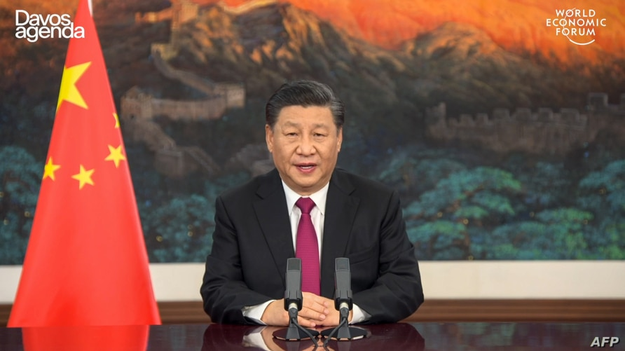 This video grab taken on Jan. 25, 2021, from the website of the World Economic Forum shows China's President Xi Jinping speaking from Pekin as he opens an all-virtual World Economic Forum, which usually takes place in Davos, Switzerland.