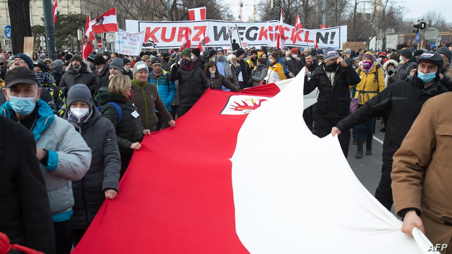 People take part in a rally against ongoing coronavirus restrictions, in Vienna, Austria, Jan. 31, 2021.