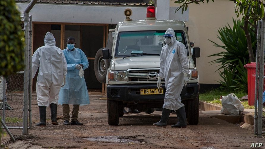 Medical personnel dressed in personal protective equipment are seen outside the main COVID-19 treatment center at Kamuzu Central Hospital in Lilongwe, Malawi, Jan. 18, 2021.